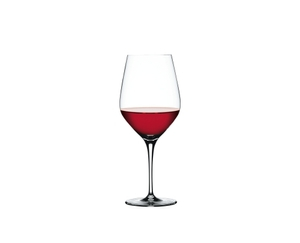 SPIEGELAU Authentis Bordeaux filled with a drink on a white background