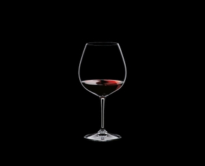 RIEDEL Restaurant Pinot Noir filled with a drink on a black background