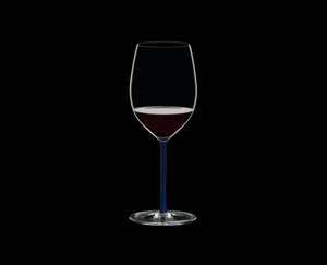 RIEDEL Fatto A Mano R.Q. Cabernet/Merlot Dark Blue filled with a drink on a black background