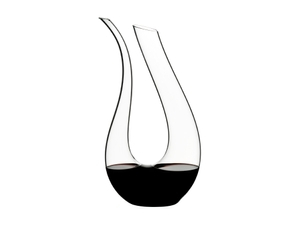 RIEDEL Amadeo Decanter filled with red wine on white background
