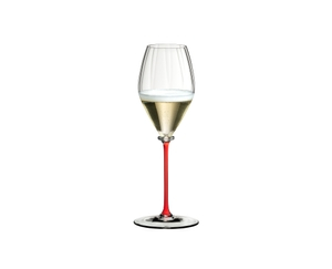 A RIEDEL Fatto A Mano Performance Champagne Glass with a red stem and filled with champagne