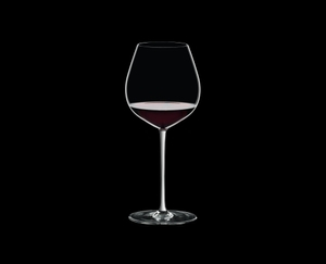 RIEDEL Fatto A Mano Pinot Noir White filled with a drink on a black background
