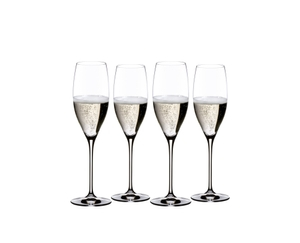 RIEDEL Vinum Champagne Glass Set filled with a drink on a white background