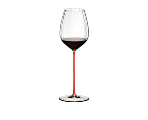 RIEDEL High Performance Cabernet Red filled with a drink on a white background