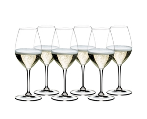6 filled RIEDEL Vinum champagne wine glasses slightly offset in 2 rows