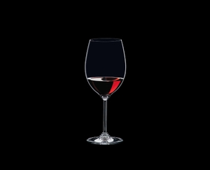 RIEDEL Wine Cabernet/Merlot filled with a drink on a black background