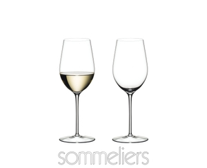 Two RIEDEL Sommeliers Riesling Grand Cru/Zinfandel glasses side by side on white background. The wine glass on the left side is filled with white wine, the other one is empty. Below the two glasses is the Sommeliers logo.