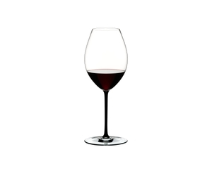 RIEDEL Fatto A Mano Syrah Black filled with a drink on a white background
