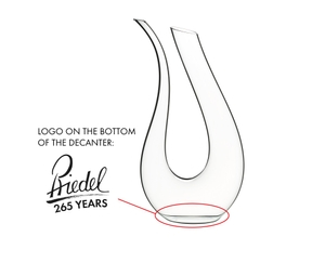 Red wine filled RIEDEL Amadeo Decanter on a white background. A red line indicates the level of 750ml wine.