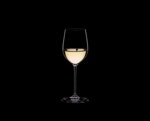 RIEDEL Vinum XL Viognier/Chardonnay filled with a drink on a black background