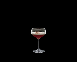 SPIEGELAU Perfect Serve Coupette Glass filled with a drink on a black background