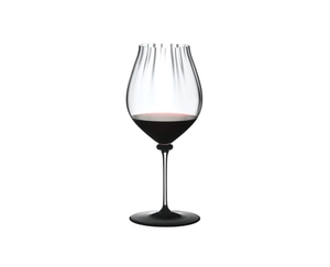 RIEDEL Fatto A Mano Performance Pinot Noir Black Base filled with a drink on a white background