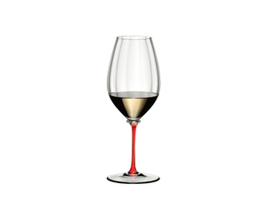 A RIEDEL Fatto A Mano Performance Riesling glass with red stem filled with white wine.