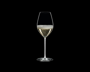 RIEDEL Fatto A Mano Champagne Wine Glass White filled with a drink on a black background