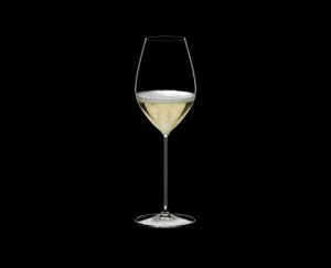 RIEDEL Superleggero Champagne Wine Glass filled with a drink on a black background
