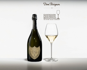 Dom Pérignon glass filled with Champagne on a white background