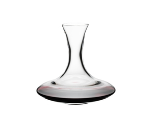 RIEDEL Decanter Ultra Magnum R.Q. filled with a drink on a white background