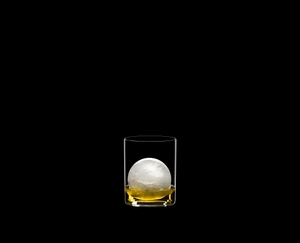 RIEDEL Bar Whisky filled with a drink on a black background
