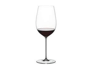 RIEDEL Superleggero Bordeaux Grand Cru filled with a drink on a white background