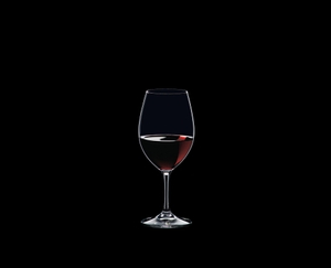 RIEDEL Ouverture Restaurant Red Wine filled with a drink on a black background