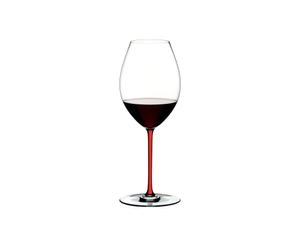 An unfilled RIEDEL Fatto A Mano Syrah red glass with a red stem on a white background with product dimensions.