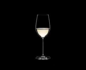 RIEDEL Veritas Restaurant Riesling/Zinfandel filled with a drink on a black background