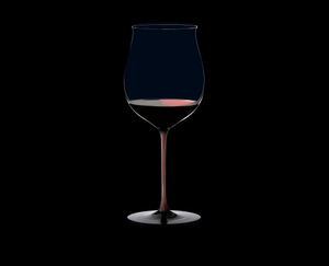RIEDEL Black Series Collector's Edition Burgundy Grand Cru filled with a drink on a black background