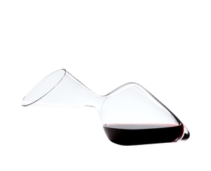 RIEDEL Decanter Tyrol filled with a drink on a white background