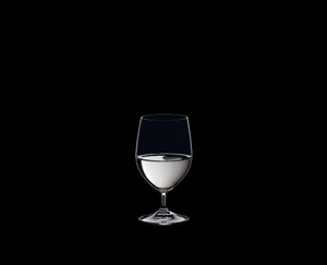 RIEDEL Ouverture Water filled with a drink on a black background