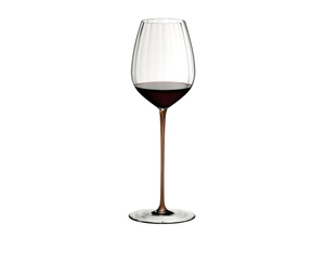 RIEDEL High Performance Cabernet Gold filled with a drink on a white background