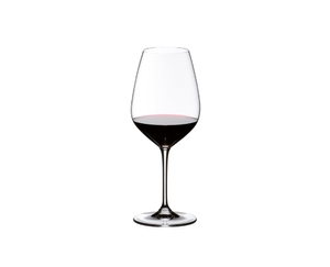 RIEDEL Vinum Extreme Syrah/Shiraz filled with a drink on a white background