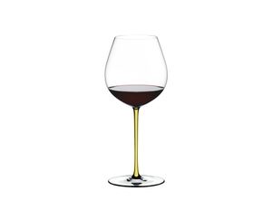 RIEDEL Fatto A Mano Pinot Noir Yellow filled with a drink on a white background