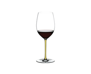 RIEDEL Fatto A Mano R.Q. Cabernet/Merlot Yellow filled with a drink on a white background
