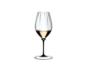 RIEDEL Fatto A Mano Performance Riesling Black Stem filled with a drink on a white background