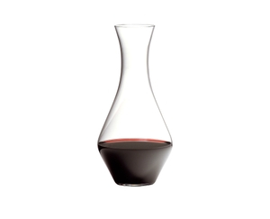 Red wine filled Cabernet Magnum Decanter on white background