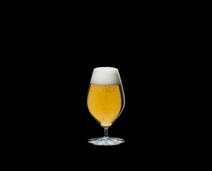 RIEDEL Veritas Restaurant Beer filled with a drink on a black background