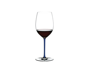 RIEDEL Fatto A Mano R.Q. Cabernet/Merlot Dark Blue filled with a drink on a white background