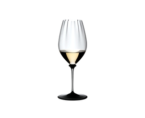 RIEDEL Fatto A Mano Performance Riesling Black Base filled with a drink on a white background