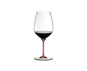 A RIEDEL Fatto A Mano Performance Cabernet Sauvignon glass with red stem fill with red wine.