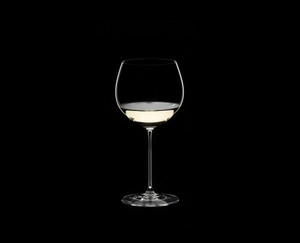 RIEDEL Veritas Restaurant Oaked Chardonnay filled with a drink on a black background