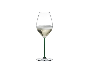RIEDEL Fatto A Mano Champagne Wine Glass Green filled with a drink on a white background