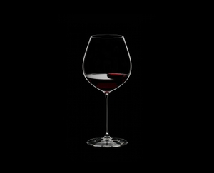 RIEDEL Veritas Old World Pinot Noir filled with a drink on a black background