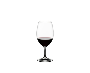 RIEDEL Ouverture + Gift filled with a drink on a white background