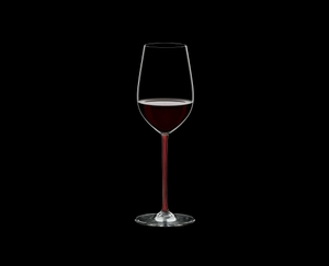 RIEDEL Fatto A Mano Riesling/Zinfandel Red filled with a drink on a black background