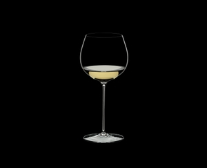 RIEDEL Superleggero Oaked Chardonnay filled with a drink on a black background