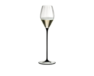 RIEDEL High Performance Champagne Glass Black filled with a drink on a white background