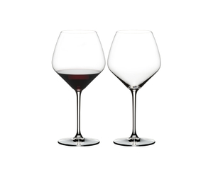 RIEDEL Heart To Heart Pinot Noir filled with a drink on a white background