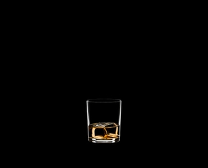RIEDEL Manhattan Single Old Fashioned filled with a drink on a black background