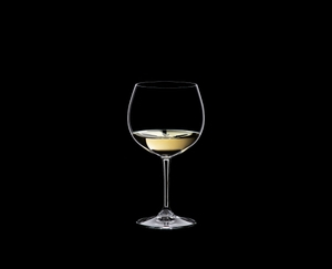 RIEDEL Restaurant Oaked Chardonnay filled with a drink on a black background