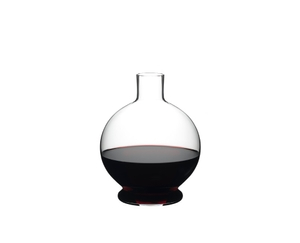 RIEDEL Decanter Marne filled with a drink on a white background